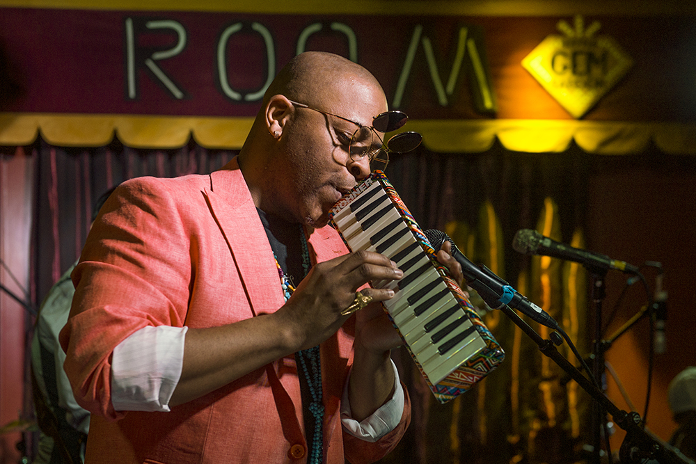 Davell Crawford performs the melodica at Little Gem Saloon on May 5, 2017 during the Basin Street Records 20th Anniversary Kickoff Event for the album Live at Little Gem Saloon