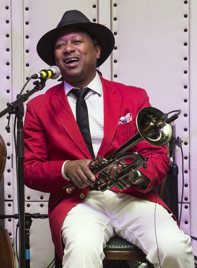 Kermit Ruffins singing and holding a trumpet at Little Gem Saloon in New Orleans, LA during the Basin Street Records 20th Anniversary Kickoff on May 5, 2017 for the album Live at Little Gem Saloon
