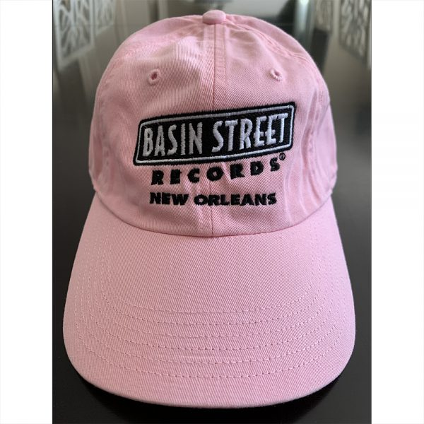 Pink baseball hat with black Basin Street Records logo on front