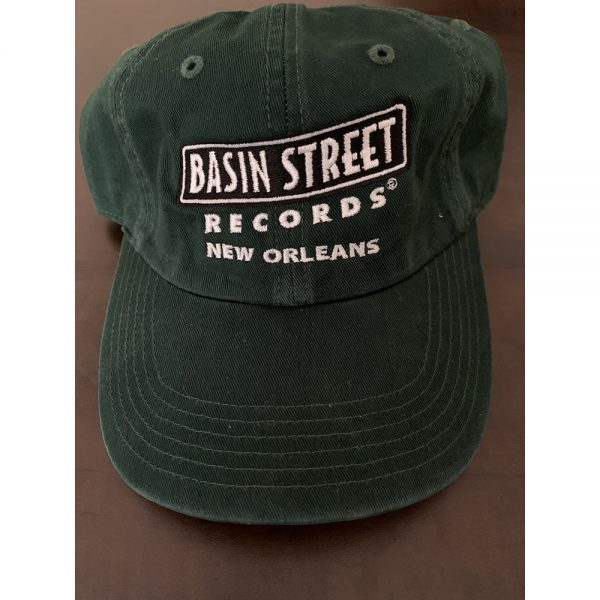 Adjustable golf/dad hat style hat in dark green color with the Basin Street Records logo embroidered on front in black