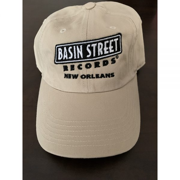 "Golf/""Dad"" hat style cap in stone color (khaki/beige) with embroidered basin street records logo in black on front"